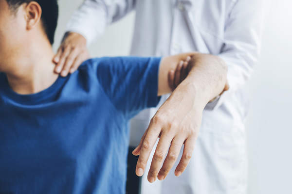 Doctor assessing a patient's joint pain
