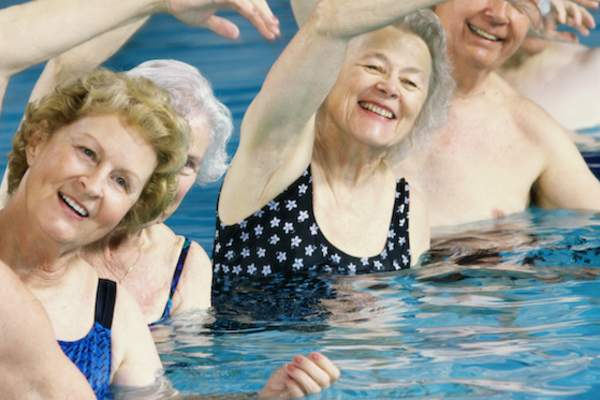 Seniors in water exercise class.