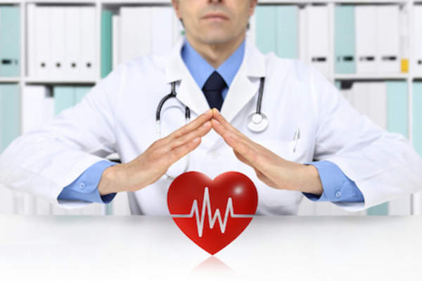 Doctor protecting heart, good health concept.