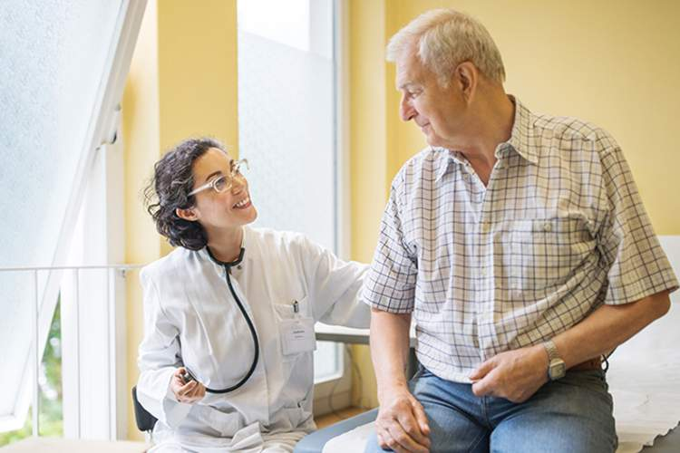 Doctor smiling at a senior patient.