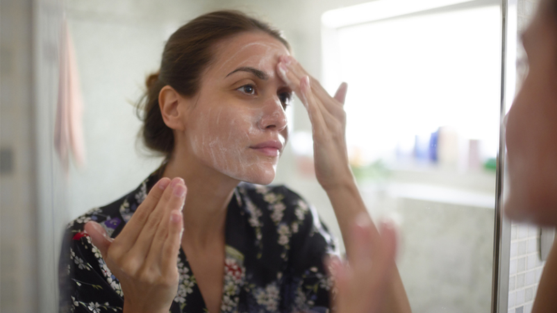 Woman using skin cream.