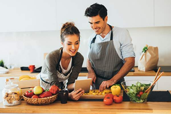 Couple making online recipe.