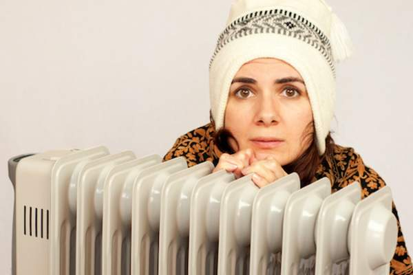 woman by heater