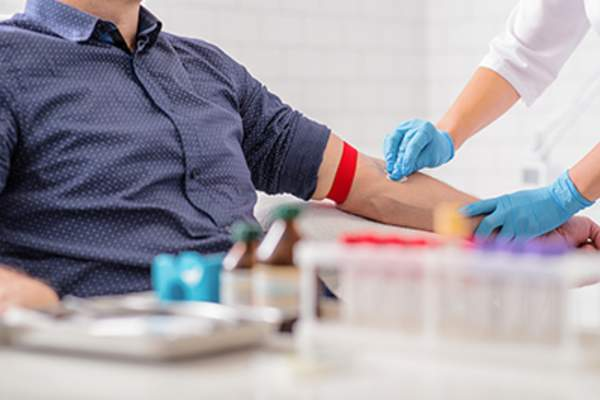 Man undergoing blood test for clinical trial concept.