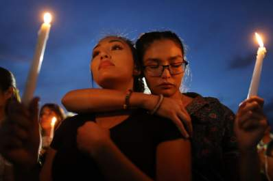People attend a candlelight vigil at a makeshift memorial honoring victims of a mass shooting on August 7, 2019 in El Paso, Texas.
