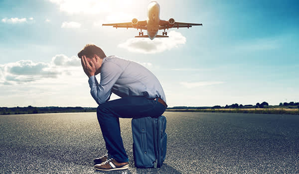 man on runway afraid of flying image