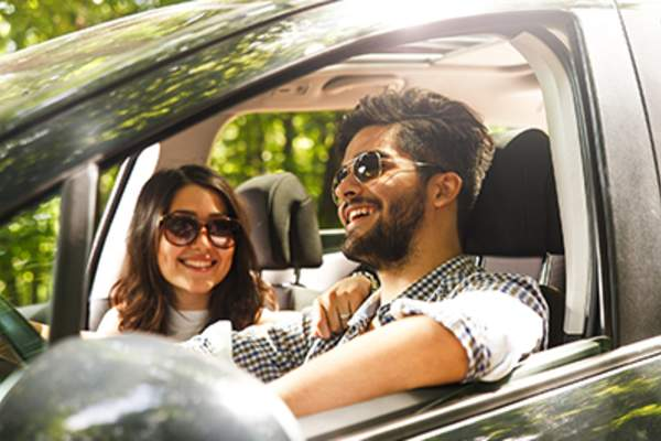 Couple smiling during a drive.