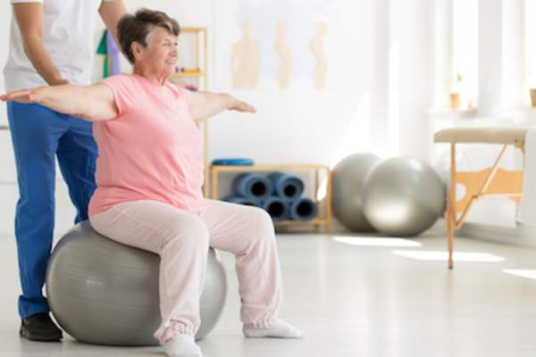 Older woman working with physical therapist