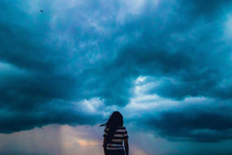 woman looking at storm