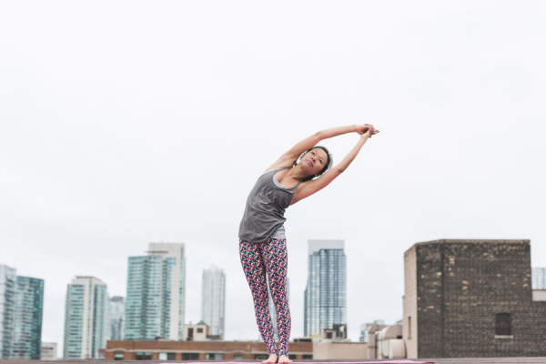 woman doing rooftop yoga