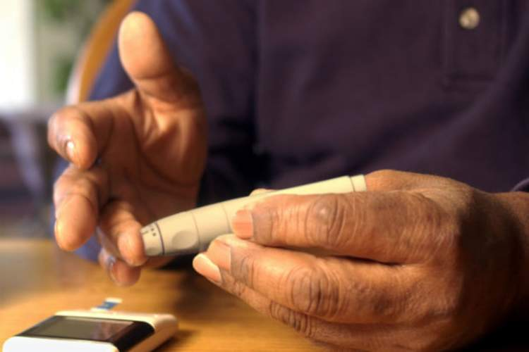 Man using Blood Glucose Meter