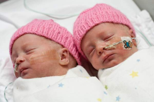 Premature twins in hospital.