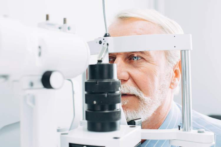 Senior man getting eye exam