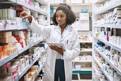 Pharmacist searching for medication.