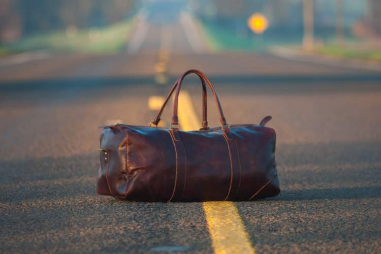 duffel bag on the road