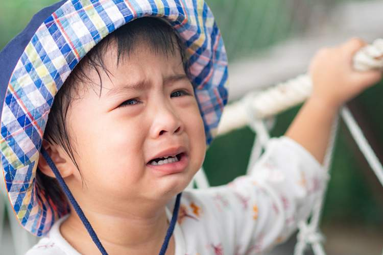 Young child crying.