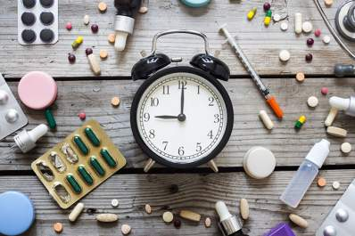 Medications and an alarm clock.