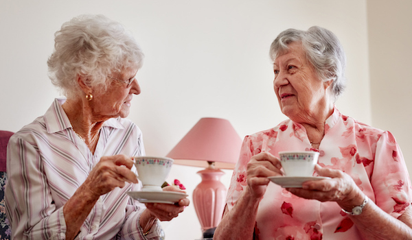 Two senior ladies having afternoon tea.
