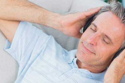 Man listening to music through headphones.