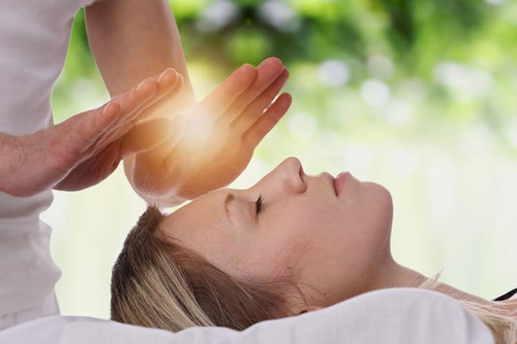 Woman receiving Reiki.