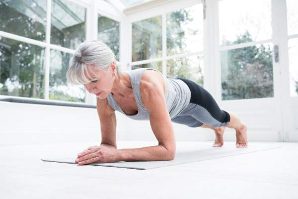 Senior woman in plank position