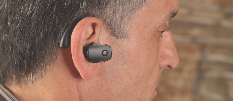 Man wearing PSAP hearing aid alternative