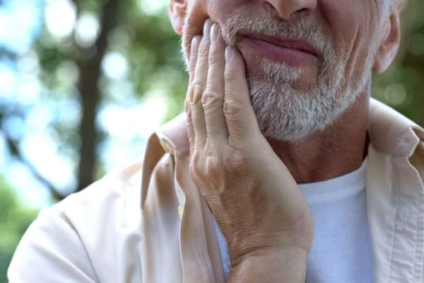 senior man with jaw pain