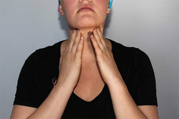 Woman checking lymph nodes in neck.