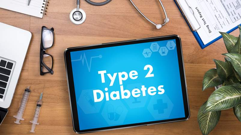 Type 2 diabetes medical concept and tablet.
