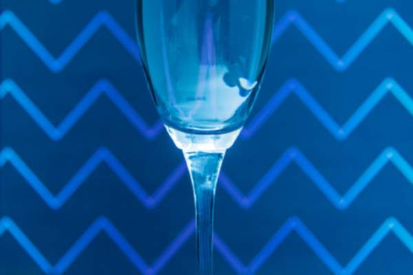 Champagne flute with blue background.