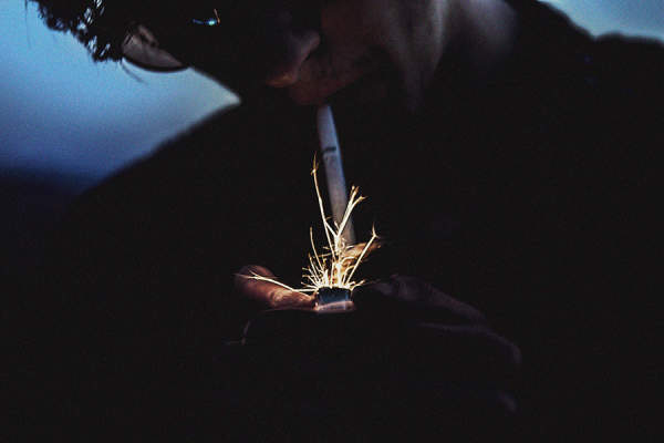 Man lighting a cigarette