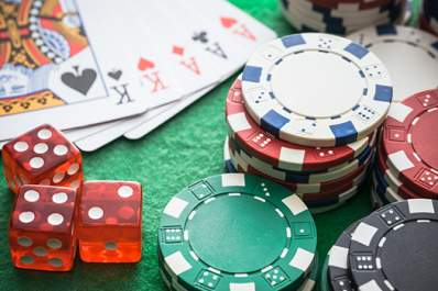Playing cards, dice, and casino chips.