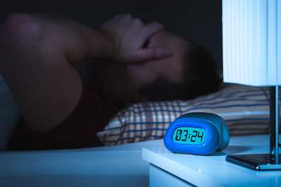 Man unable to sleep at night.