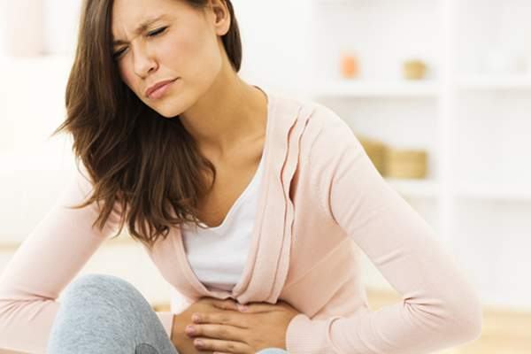Woman with stomach pain image.