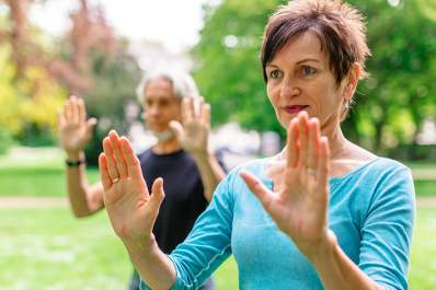 couple doing tai chi in park image