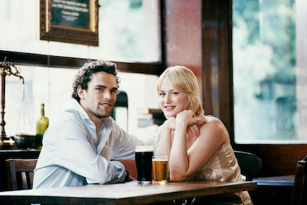 Young couple having a pint at the pub.