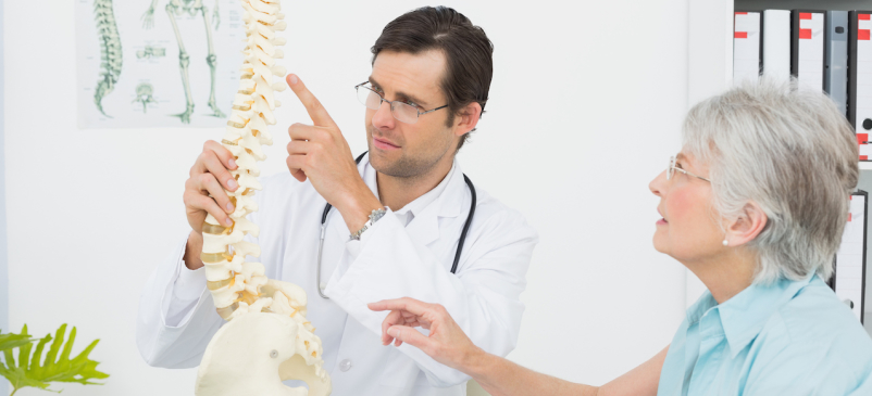 Chiropractor explaining spine to patient