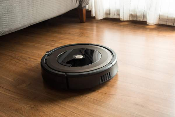 Robot vacuum cleaner on wood