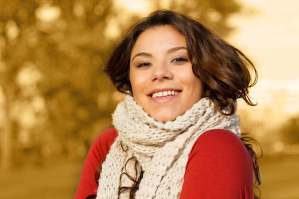 Woman in scarf smiling