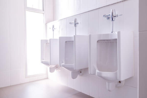 line of white urinals