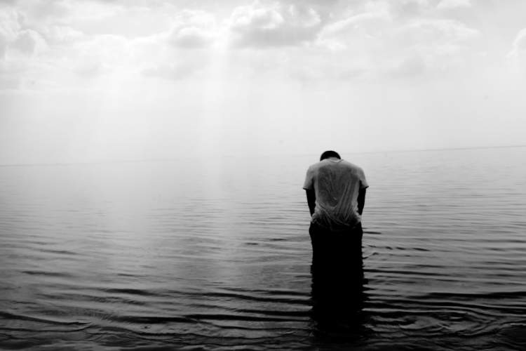 depressed man alone in the water