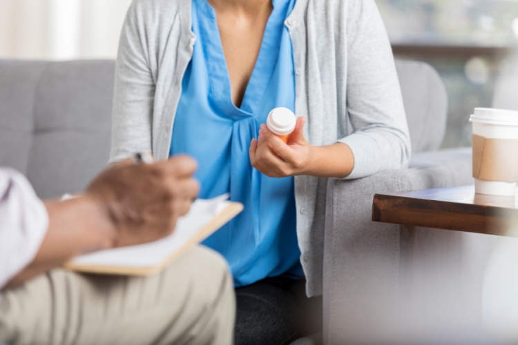 woman receives new prescription from doctor