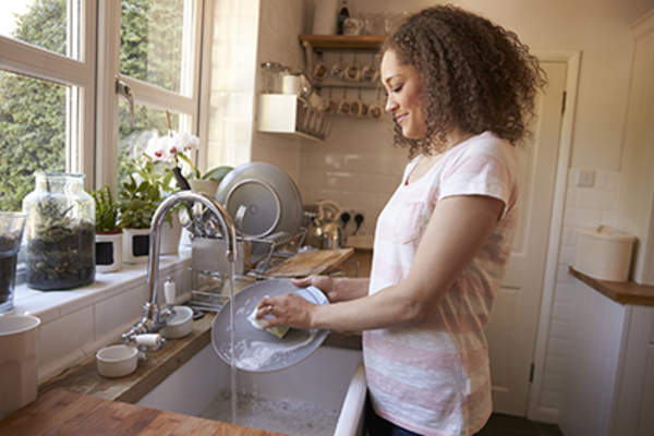 Woman washing the dishes.