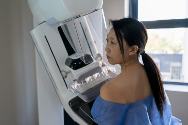 Middle-aged woman getting mammogram