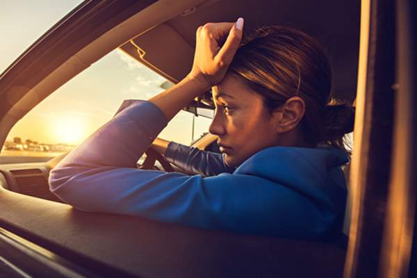 worried woman in the car image