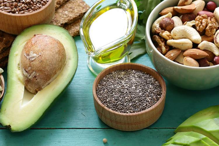 Healthy fats for people with crohn's disease including avocado, seeds, nuts, and olive oil.