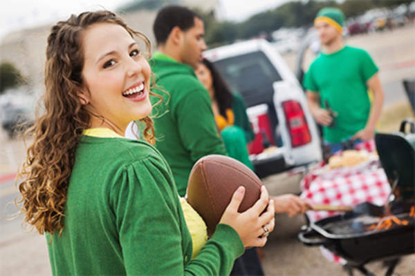 Young people tailgating.