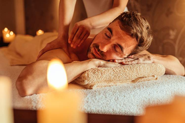 Man enjoying a massage at a spa.