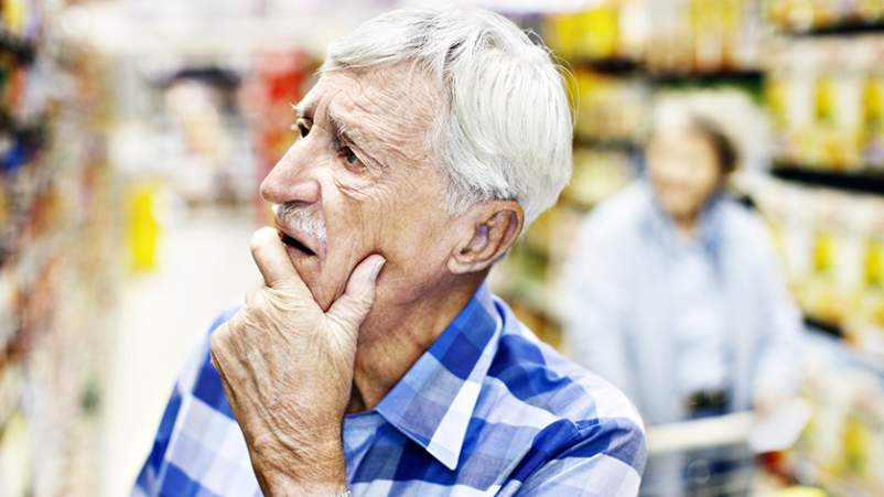 Confused senior in a grocery store.