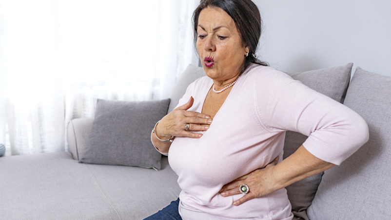 Woman having a heart attack.